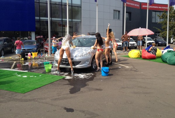 Four sexy girl wash a car