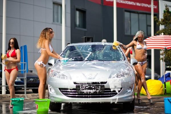 Four sexy girl wash a car