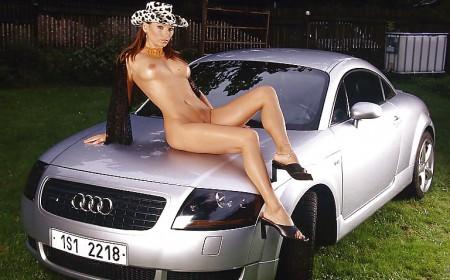 Hot Redhead Girl posing on Audi