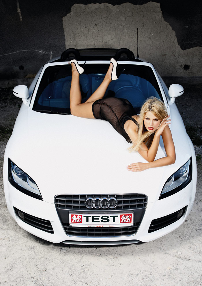 Sexy blonde Tina poses with Audi