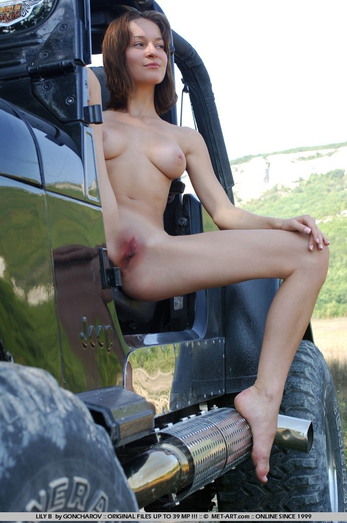 Sexy Brunette Lily posing in Jeep