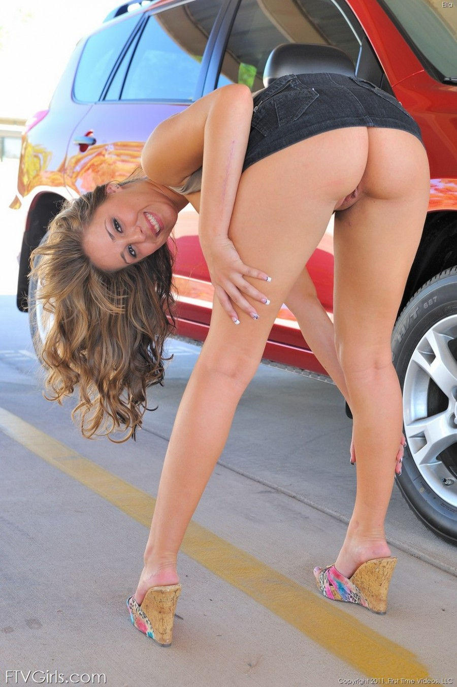 Sexy Babe Ella flashes near the Toyota