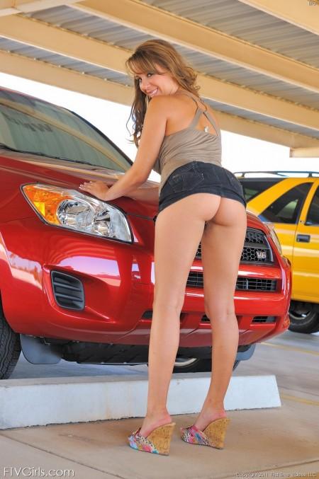 Sexy Babe Ella flashes near the Toyota